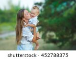 cute stylish young mother lady... | Shutterstock . vector #452788375
