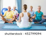 instructor performing yoga with ... | Shutterstock . vector #452799094