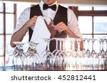 Mid Section Of Bartender...