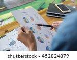 business team working on laptop ...   Shutterstock . vector #452824879