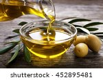 bottle pouring virgin olive oil ... | Shutterstock . vector #452895481