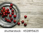 Fresh Cherries On Wooden Table...