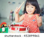 Little Girl Playing Drum At...