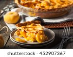 homemade warm peach pie ready... | Shutterstock . vector #452907367