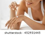 woman hand with cream. closeup... | Shutterstock . vector #452931445