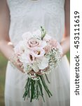 bride holding wedding bouquet  | Shutterstock . vector #453111619