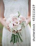bride holding wedding bouquet    Shutterstock . vector #453111619
