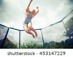 girl jumping on a trampoline | Shutterstock . vector #453147229