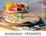 pizza and tropical fresh fruits | Shutterstock . vector #453164431