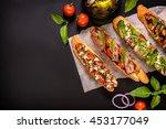 various bruschettas on a black... | Shutterstock . vector #453177049