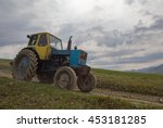 Old Tractor Riding In The...