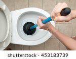 Small photo of Toilet repair by hand Plumbing