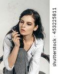 girl smokes a cigarette. she is ... | Shutterstock . vector #453225811