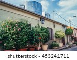 Small photo of Tel Aviv, Israel - October 20, 2015. Small house with building of Trade Tower on background in historic Neve Tzedek district (lit. Abode of Justice) in southwestern part of Tel Aviv
