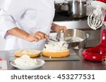 chef decorating a delicious... | Shutterstock . vector #453277531