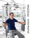 happy man at the gym exercising ...   Shutterstock . vector #45332566