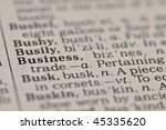 Extreme close up of the word BUSINESS found inside a dictionary - stock photo