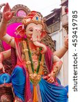 Small photo of MUMBAI, INDIA - SEPTEMBER 18, 2013 : Devotees bids adieu to Lord Ganesha as the ten-day-long Hindu festival ends in Mumbai.