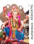 Small photo of MUMBAI, INDIA - SEPTEMBER 18, 2013 : Devotees bids adieu to Lord Ganesha as the ten-day-long Hindu festival ends in Mumbai.