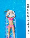 relaxing in a swimming pool on... | Shutterstock . vector #453501481