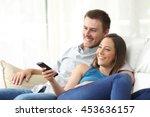 happy couple watching tv at... | Shutterstock . vector #453636157