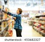 man shopping in supermarket... | Shutterstock . vector #453682327