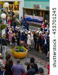 Small photo of AKUREYRI, ICELAND - JUNE 17, 2016: Locals and visitors attend the Independence Day parade in the main street of Akureyri, Iceland