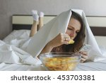 Girl Eating Chips In Bed And...