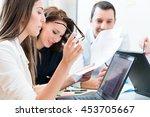 women and men in office reading ... | Shutterstock . vector #453705667