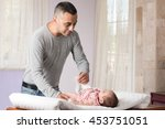 father is changing diaper of... | Shutterstock . vector #453751051