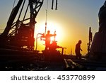 oil field oil workers at work | Shutterstock . vector #453770899