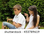 Small photo of Small girl pointing an accusing finger at a boy