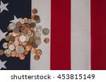 A Pile Of Change On Top Of An...