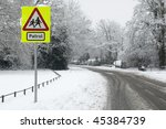 deserted urban street crossing due to snow - stock photo