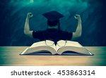 the glasses over the books on... | Shutterstock . vector #453863314