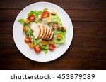 caesar salad with chicken and... | Shutterstock . vector #453879589