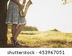 young woman in a dress stands... | Shutterstock . vector #453967051