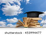 books and mortarboard on wooden ... | Shutterstock . vector #453994477