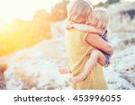 mom playing with her child... | Shutterstock . vector #453996055
