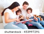 girls twins with parents read... | Shutterstock . vector #453997291
