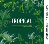 tropical palm leaves background.... | Shutterstock .eps vector #454014391