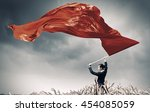 Woman Waving Red Flag . Mixed...