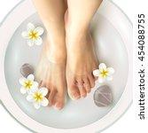 pedicure spa female feet in spa ... | Shutterstock .eps vector #454088755