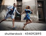 woman in blue dress with... | Shutterstock . vector #454092895