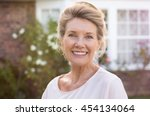happy senior woman standing... | Shutterstock . vector #454134064