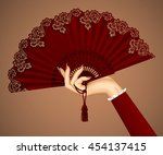 female hand with open vintage... | Shutterstock .eps vector #454137415