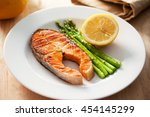 grilled salmon steak with... | Shutterstock . vector #454145299