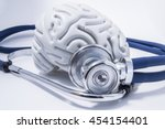 Stock photo the figure of the human brain with a stethoscope or phonendoscope around him picture for medical 454154401