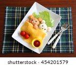 homemade bear shaped omelet rice | Shutterstock . vector #454201579