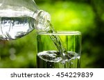 drink water pouring in to glass ... | Shutterstock . vector #454229839